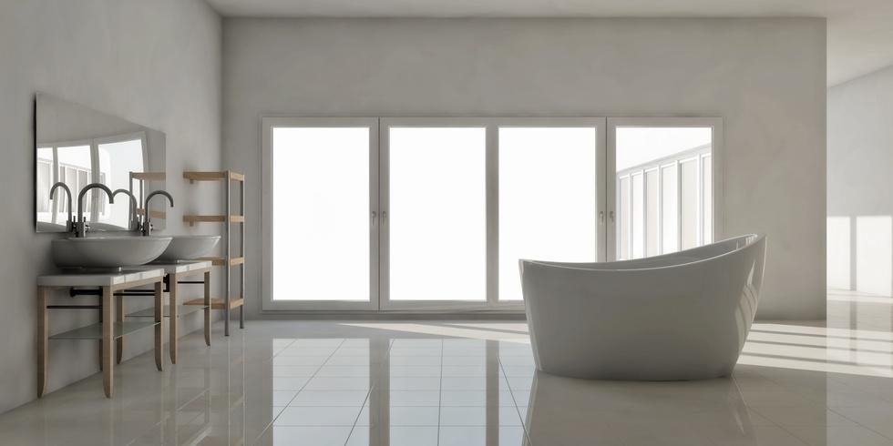Weißes Designerbad mit freistehender Badewanne und großer Glasfront mit Blick ins Freie